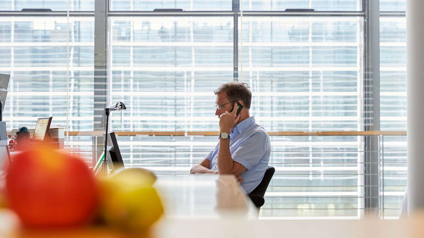 Employee talking on phone by computer
