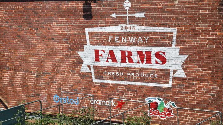 A brick wall depicting art that refers to baseball and the Boston Red Sox.