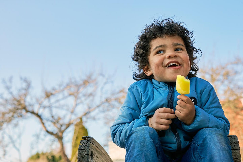 Toddler eating an icecream
